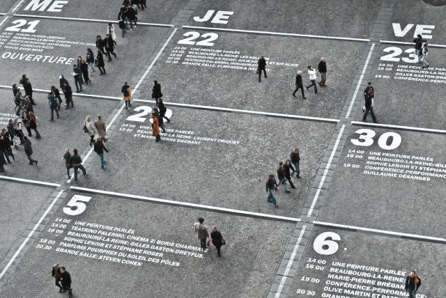 Field turned into calendar with people walking about