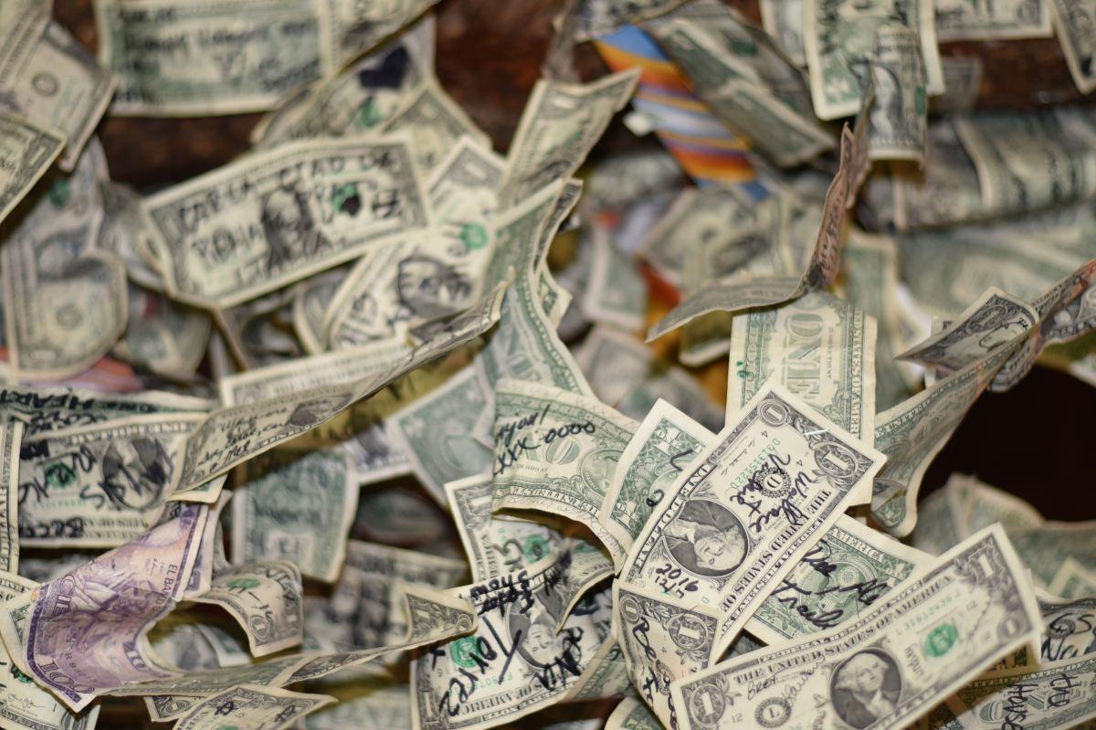 piles-of-usa-one-dollar-bills