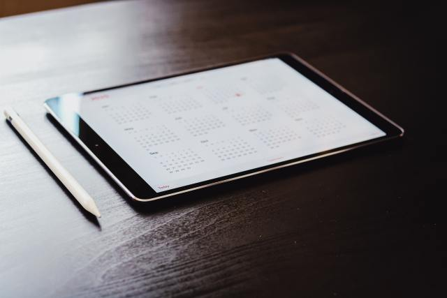 digital calendar on tablet device on a table