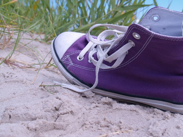 close-up-of-purple-sneakers-and-shoe-strings