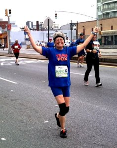 """Mom, around mile 7 in Brooklyn. (The """"Fox"""" on her shirt is for the Michael J. Fox Foundation, the charity with which she ran)"""