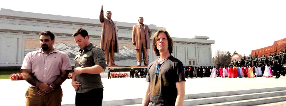 In front of colossal Kim statues