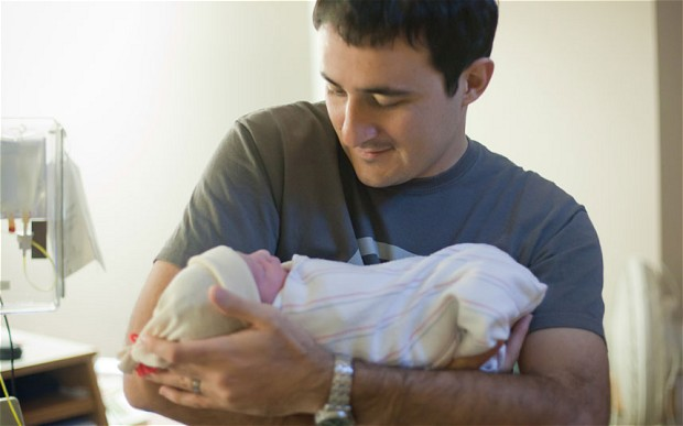 man with baby
