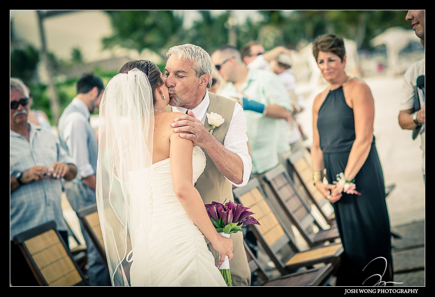 Father of the bride kisses his daughter as he give her away.Destination Wedding at Grand Velas Resort in Playa Del Carmen, Mexico. Wedding Pictures and photos by top destination wedding photographer Josh Wong Photography