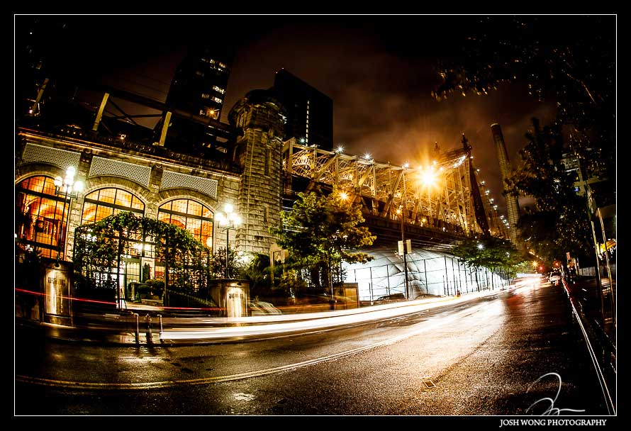 A spectacular nighttime view outside the doors of Guastavino's with the Queensboro Bridge in the background. Wedding photos by NYC Wedding photographer Josh Wong