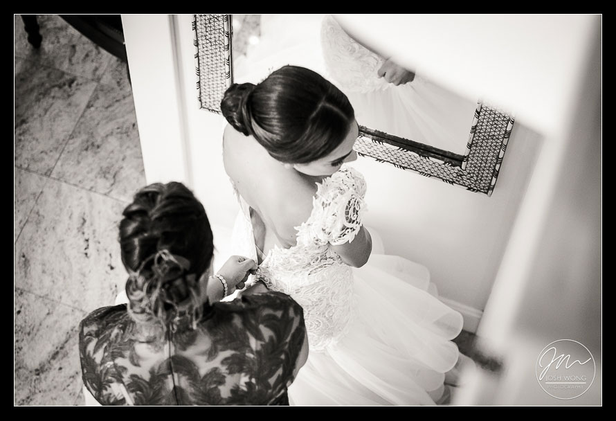 The bride slipping into her wedding dress.  New York Wedding pictures by Armenian wedding photographer Josh Wong Photography