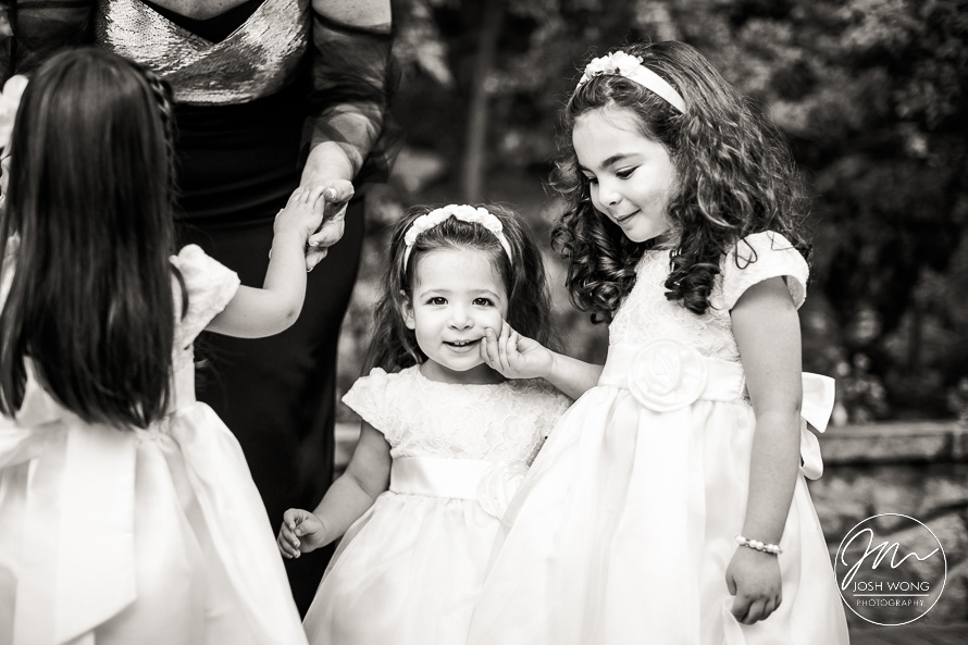 The flowers girls hand a candid moment. Gorgeous wedding photography at Tappan Hill Manion in Tarrytown. New York Wedding Pictures by Josh Wong Photography