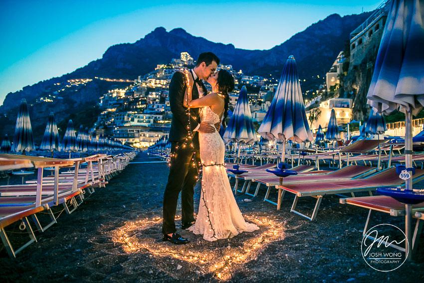 Evening and night time wedding beach photo in Positano Italy by Destination Wedding Photographer Josh Wong Wedding Photography