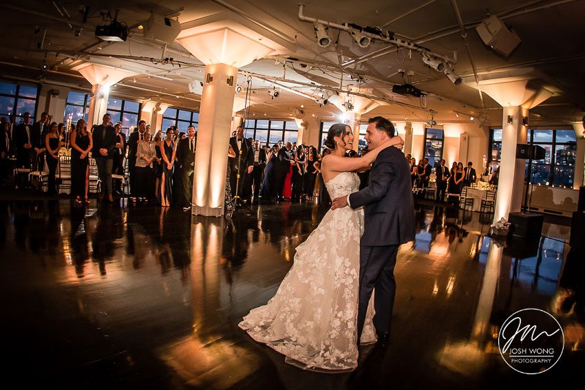 Guest watch the bride and groom dancing at Tribeca 360. New York Weddings. First Dance