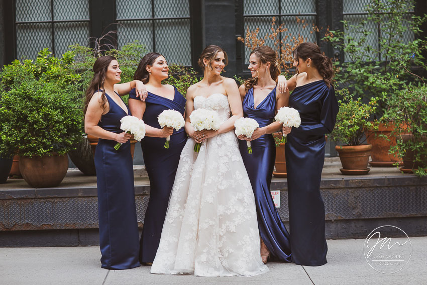 The bride and her bridesmaids in the street of Tribeca