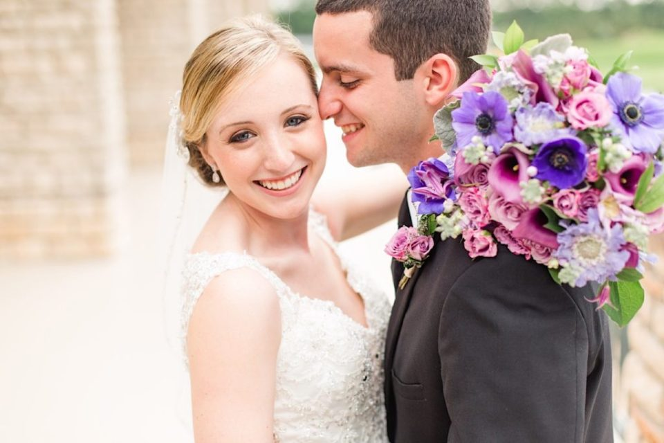 Bride and Groom with a purple and pink bouquet by A Garden Party at Scotland Run Golf Club in New Jersey