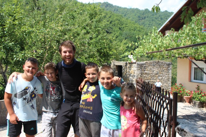 Meeting friendly local children on my bike touring adventure in Bosnia.