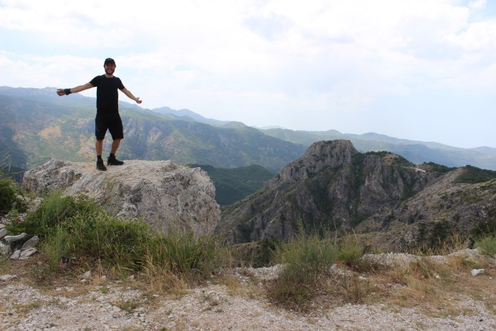 Bike touring adventure at top of mountain pass in Montenegro.