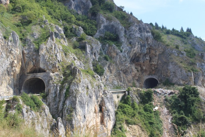 Bike touring adventure through exciting tunnels in the mountains of Montenegro.