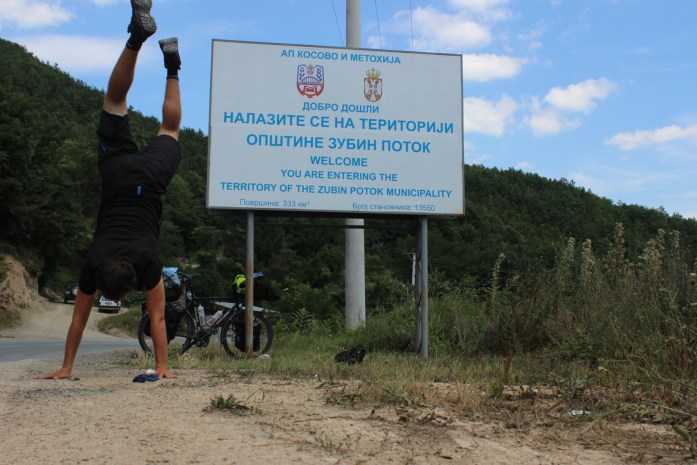 Crossing the border into Kosovo on my bike touring adventure.