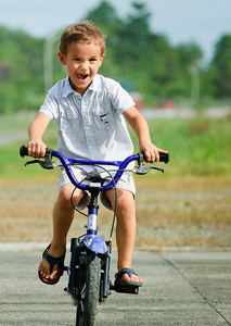 really-happy-kid-on-bike-copy