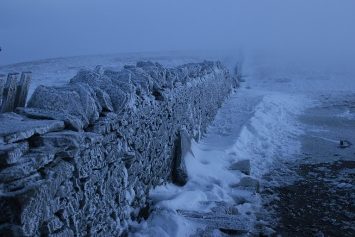 Frosty cold wall on summit of Pen Y Ghent in Yorkshire