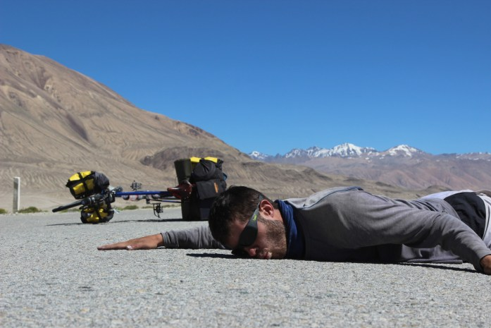 Pamir Highway kissing the ground after leaving the off-road of the Wakhan Valley.