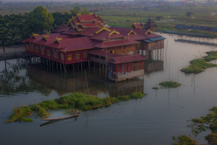 A floating monastery on stilts taken from hot air balloon.