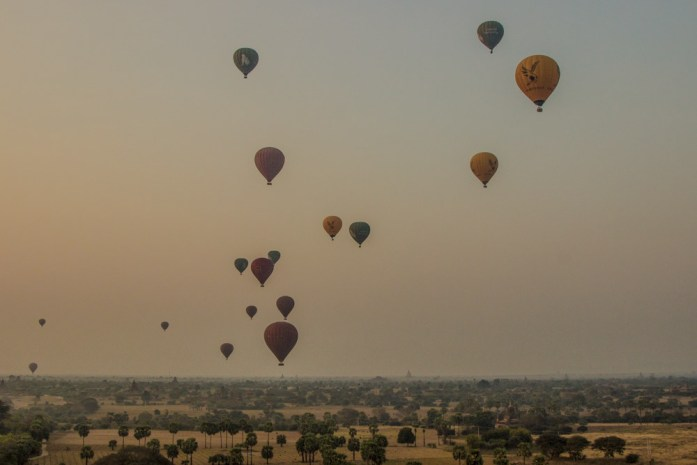 Many other hot air balloons in the sky over Bagan, Myanmar.