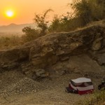 Illegal wild camp in Myanmar. MSR Tent in a quarry at sunrise.