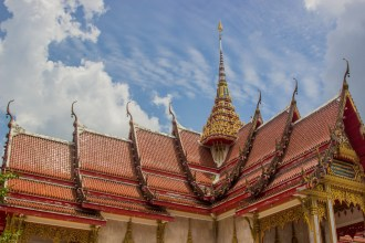 Roof of Thai monastery in Thailand. Thailand style, red and beautiful in the sun.