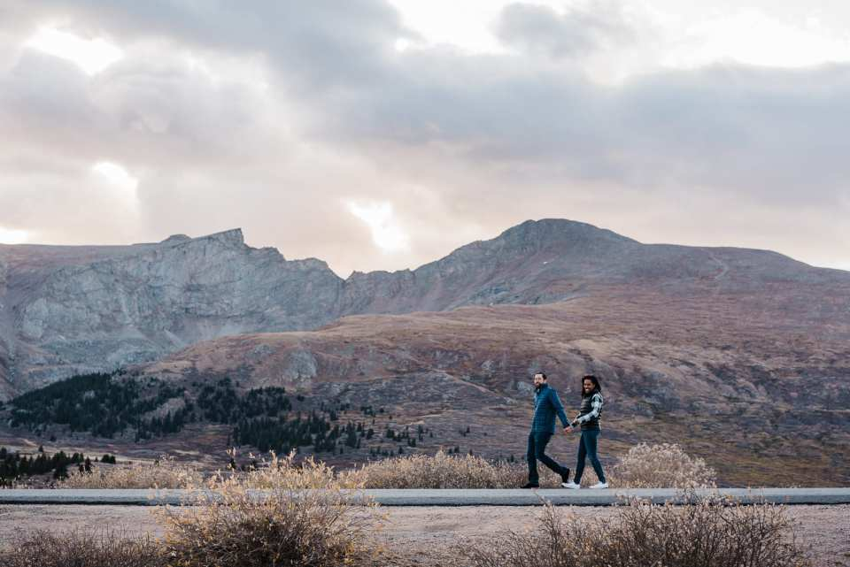 Couple walking by mountain