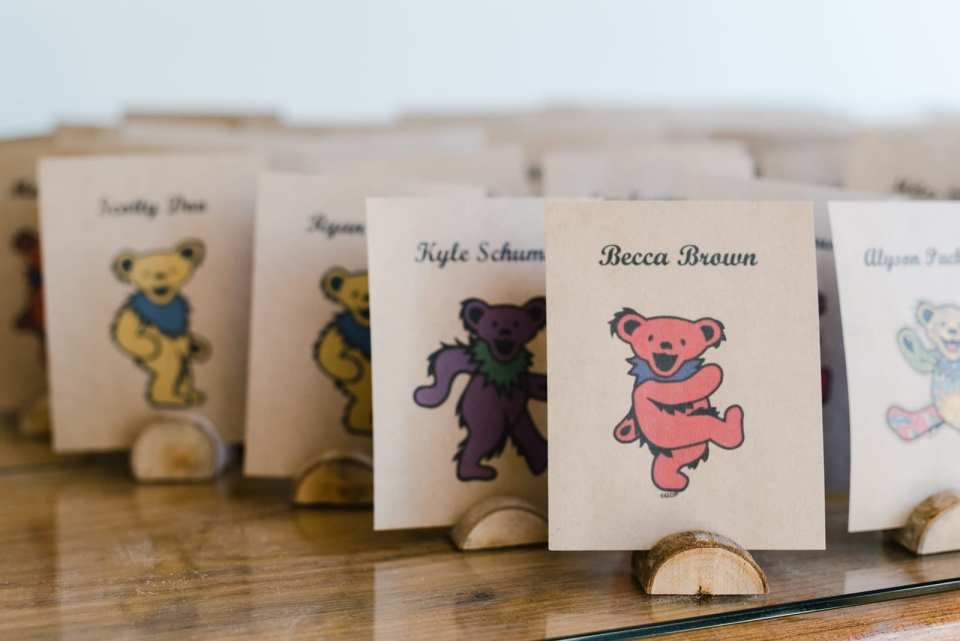 Grateful Dead themed place cards at hippie wedding by Josie V Photography
