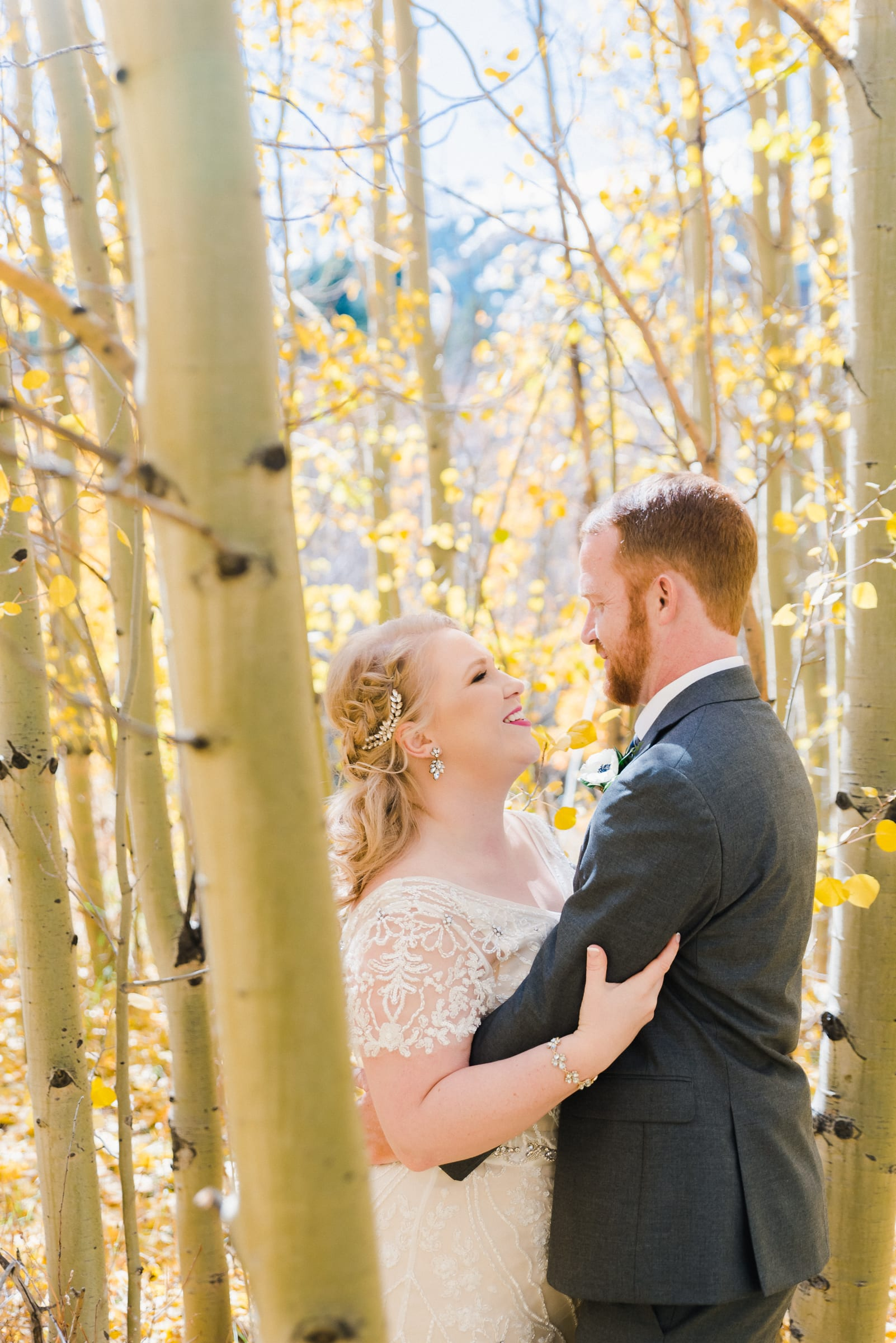 Couple embraces for their wedding in the Colorado Fall | Josie V Photography
