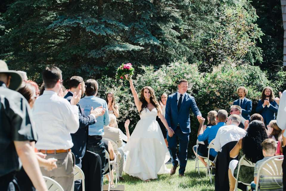 Couple walks down the aisle together at their summer Colorado Wedding by Josie V photography