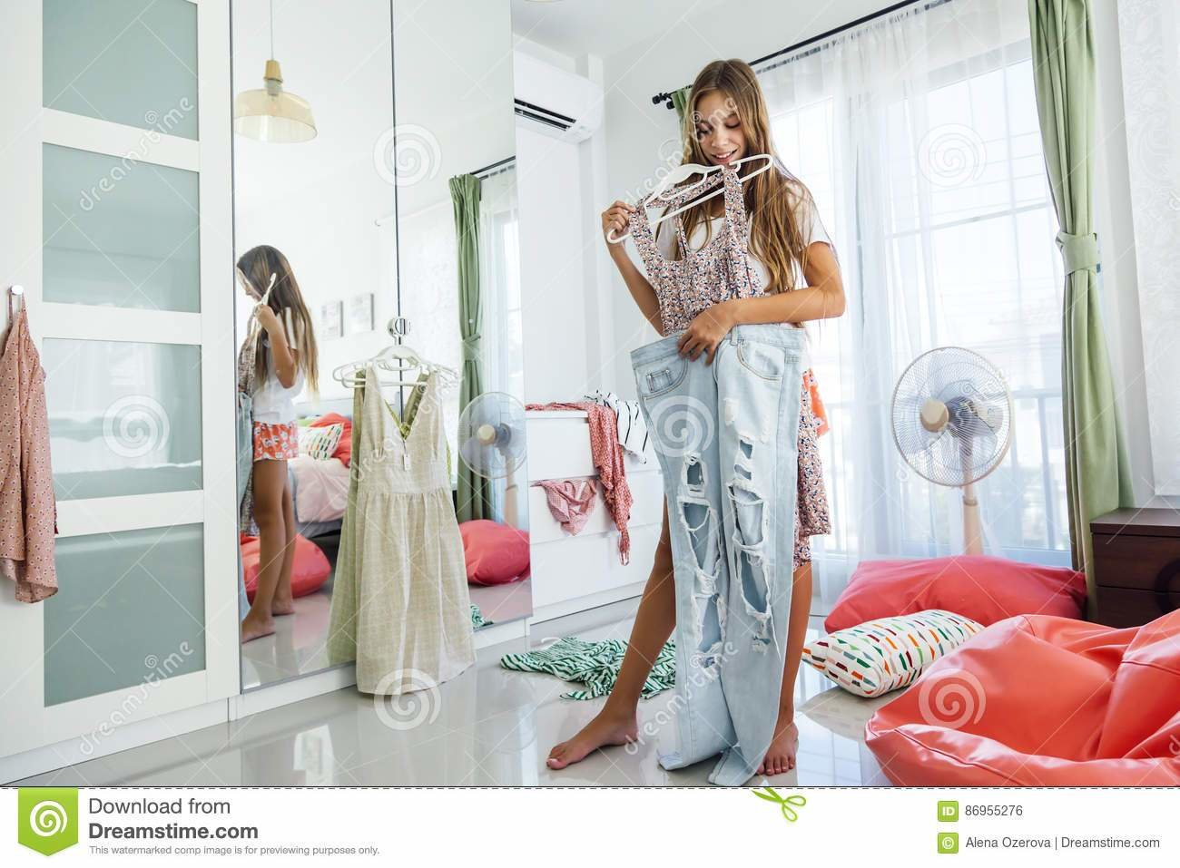 Best Teenage Girl Choosing Clothing In Closet Royalty Free With Pictures
