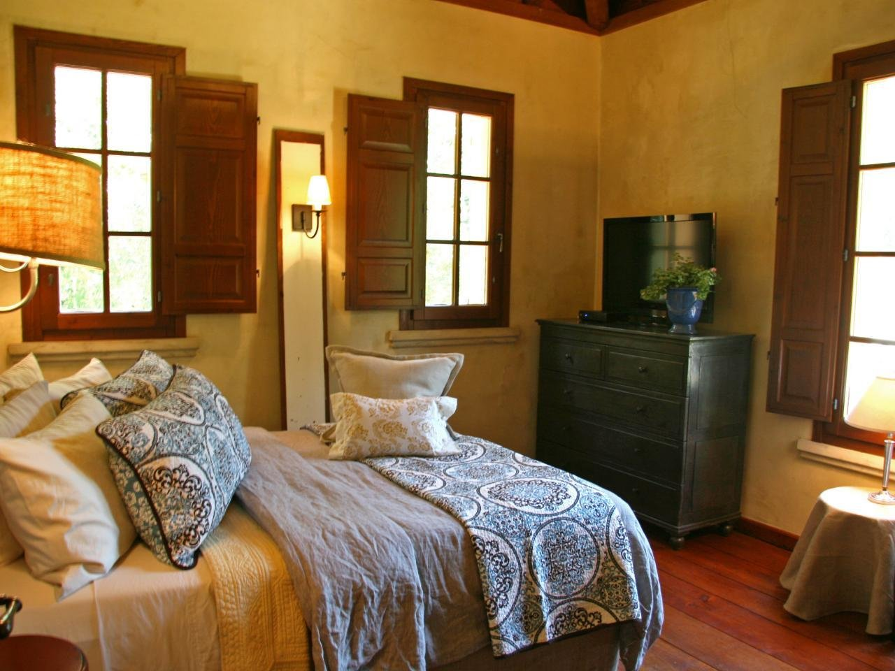 Best Rustic Western Bedroom With Wooden Shutters Hgtv With Pictures