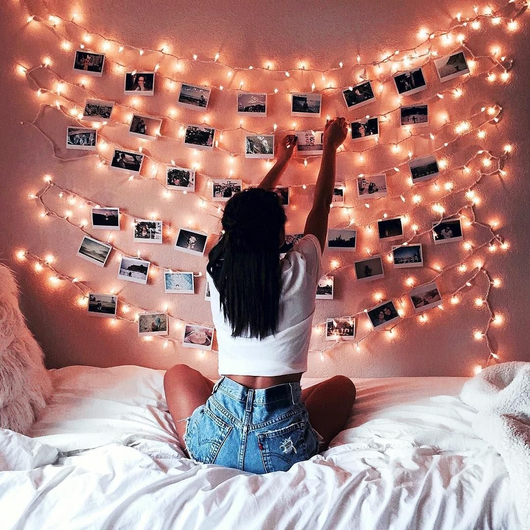 Best Decoration With Fairy Lights And Photos On A Pink Wall With Pictures