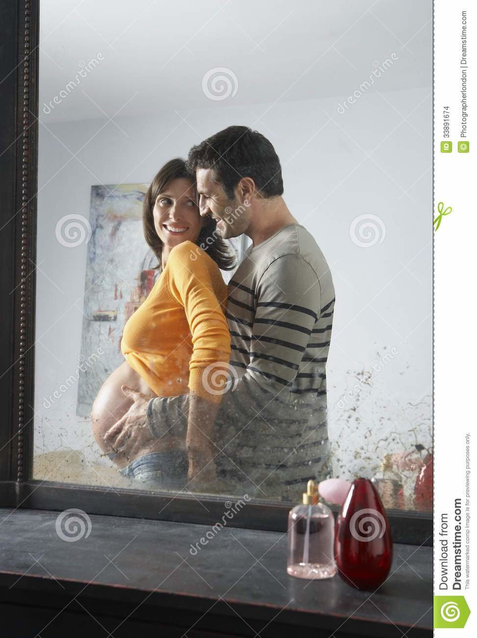 Best Reflection Of Man Embracing Pregnant Woman Stock Images With Pictures