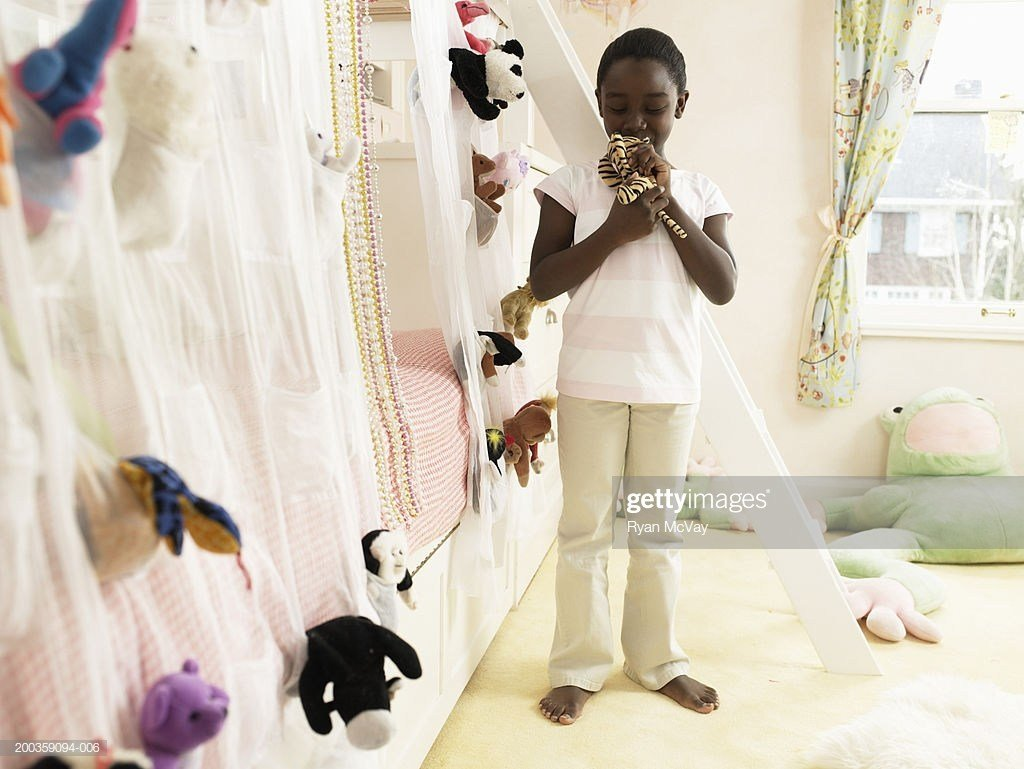 Best Girl Kissing Stuffed Animal In Bedroom Stock Photo Getty With Pictures