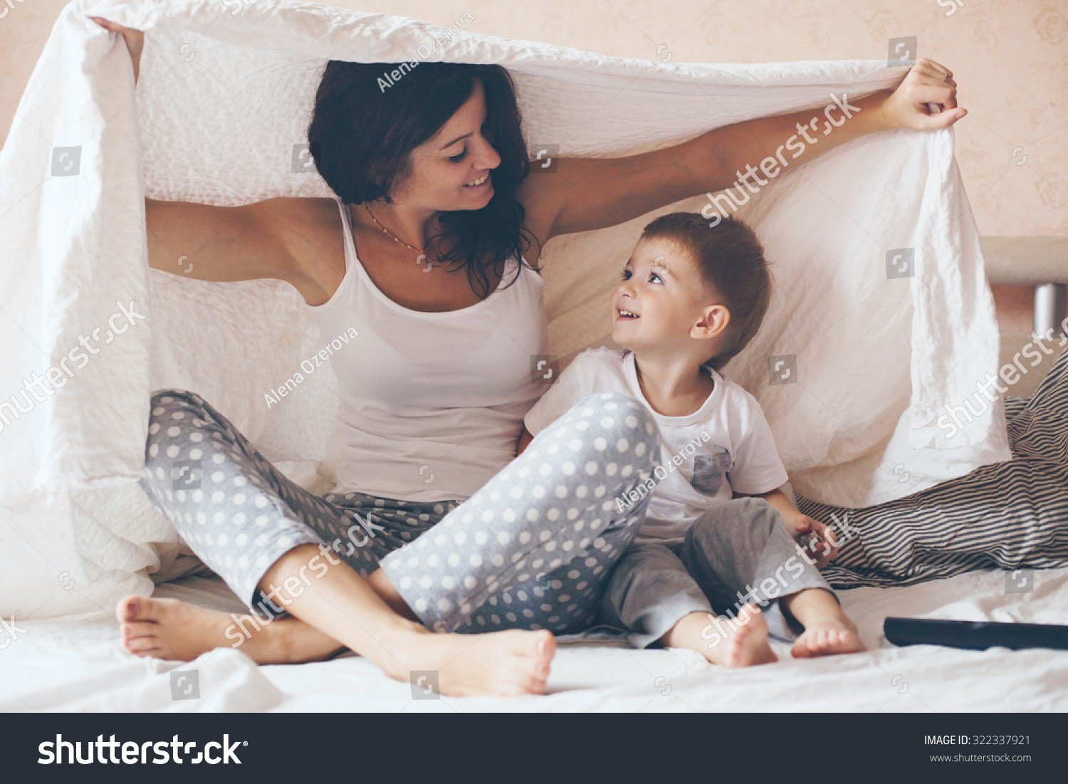 Best Young Mother With Her 2 Years Old Little Son Dressed In Pajamas Are Relaxing And Playing In The With Pictures