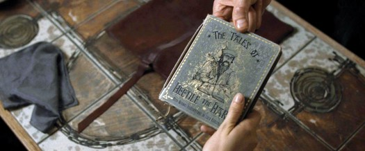 DH1_Scrimgeour_passing_The_Tales_of_Beedle_the_Bard_book_to_Hermione_Granger