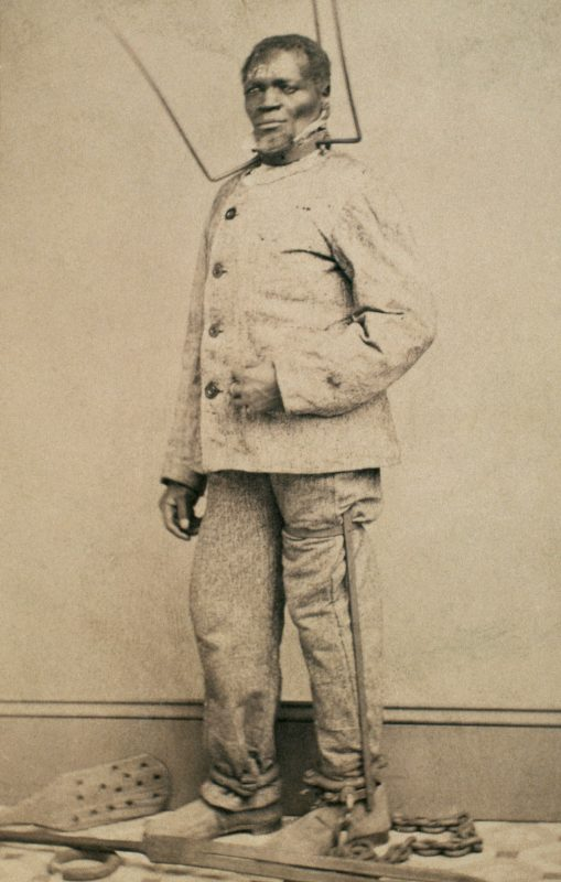 Wilson Chinn, a branded slave from Louisiana--Also exhibiting instruments of torture used to punish slaves (1863). Courtesy Library of Congress.