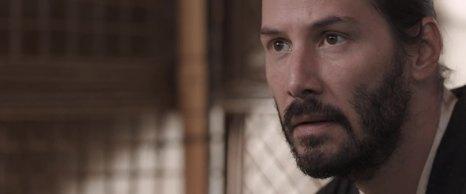 """Keanu Reeves interpreta Kai 魁, un """"mezzo-sangue"""" entrato a far parte del seguito di Asano Naganori, ma che non è praticamente stato accettato da nessuno, se non Asano stesso e sua figlia Mika."""