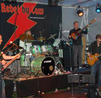 Cover Rock Live mit Rebel by Law