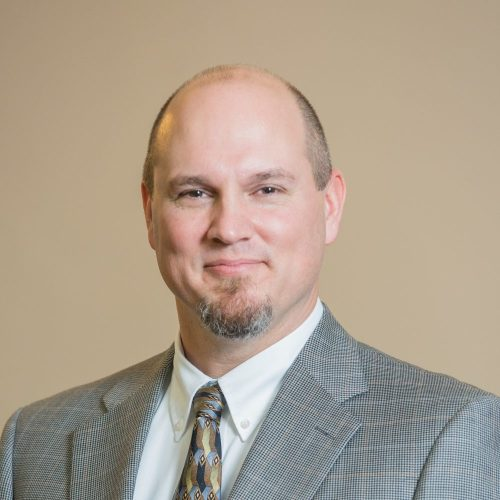 Dr. Clayton J. Williams