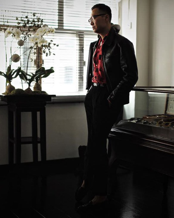 Casual vintage style with a sport shirt and leather jacket.