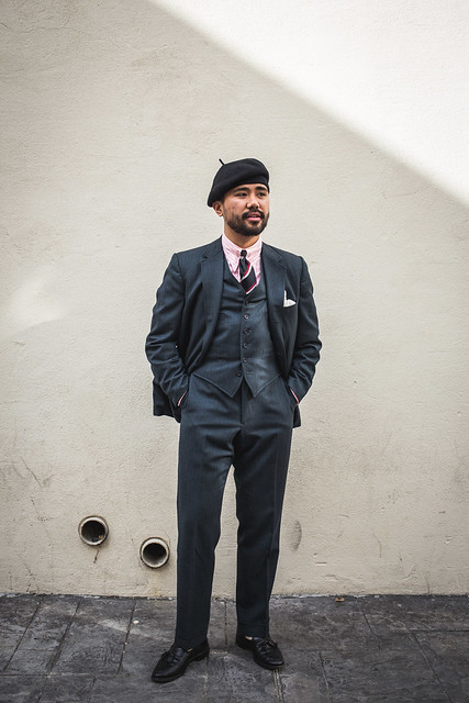 3PC flannel suit with black beret, black repp, and black loafers.