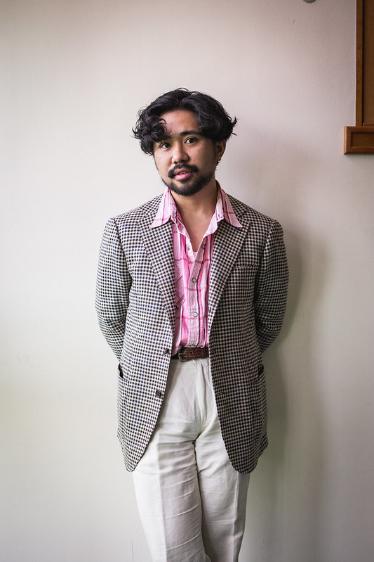 Brown houndstooth (Ring Jacket) with a pink western shirt and linen trousers.