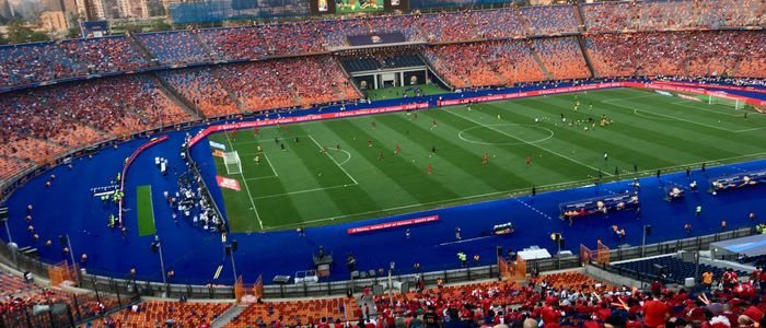 Watching Football Game in Action at Olympic standard sports facilities