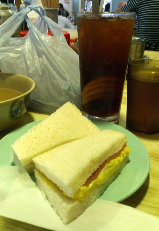 Egg sandwich again with iced lemon tea.