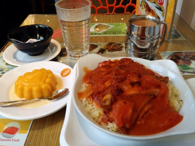 Baked pork chop rice in tomato sauce. Dessert on the left is mango pudding.