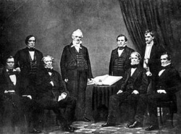 Buchanan and His Team of Confederates: (l-r) Jacob Thompson, Lewis Cass, John B. Floyd, President Buchanan, Howell Cobb, Isaac Toucey, Aaron V. Brown, and Jeremiah S. Black. Courtesy of the Library of Congress.