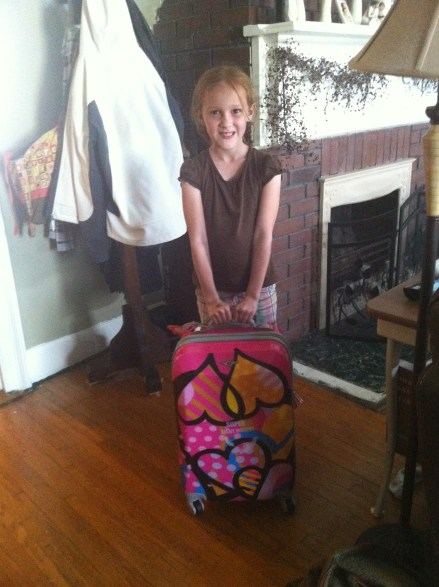 Anna ready to pack with her new suitcase given to her just for this trip by the sweet Lois Robb!