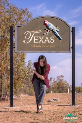 Woman in front of Texas, Queensland town sign
